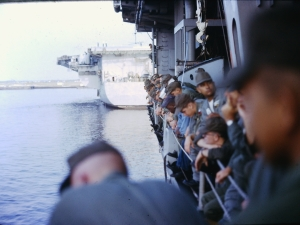 A few of my close buddies leaning over the ship rail. I flew back thirteen months later, but some of these guys did not.